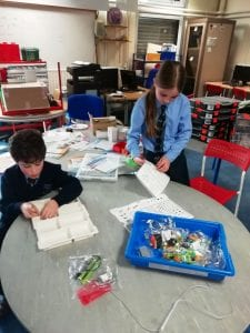 Ninjas get busy setting up the component trays for LEGO WeDo kits
